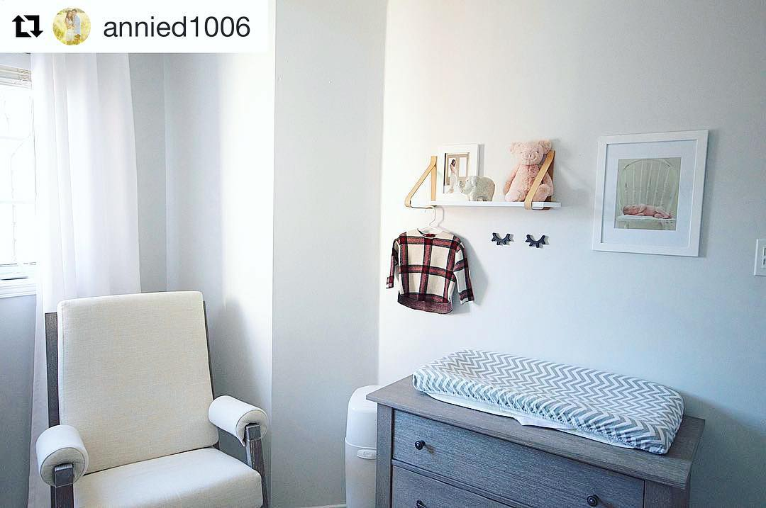 Baby room featuring senza rocking chair with linen weave cushions, a wooden dresser and changing mat