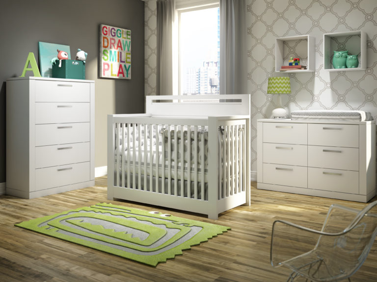 Grey baby nursery with white and beige patterned wallpaper, featuring a white crib, double dresser and 5 drawer dresser
