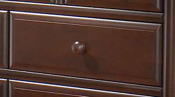 Close up of dark brown wood dresser drawer