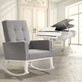 White wooden rocking chair with grey cushions in a big white room with a white grand piano