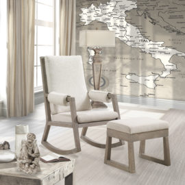 Wooden rocking chair and ottoman with white linen cushions in a room with a map of italy wallpaper