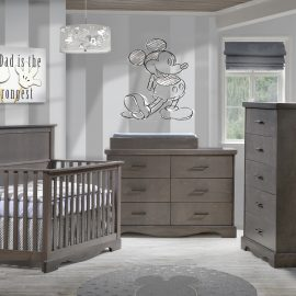 Grey baby nursery with mickey mouse on wall, with dark wooden crib, double dresser and 5 drawer dresser
