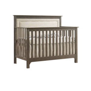Emerson dark wooden crib with a linen upholstered panel