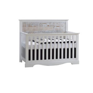 White wooden crib with white bark headboard