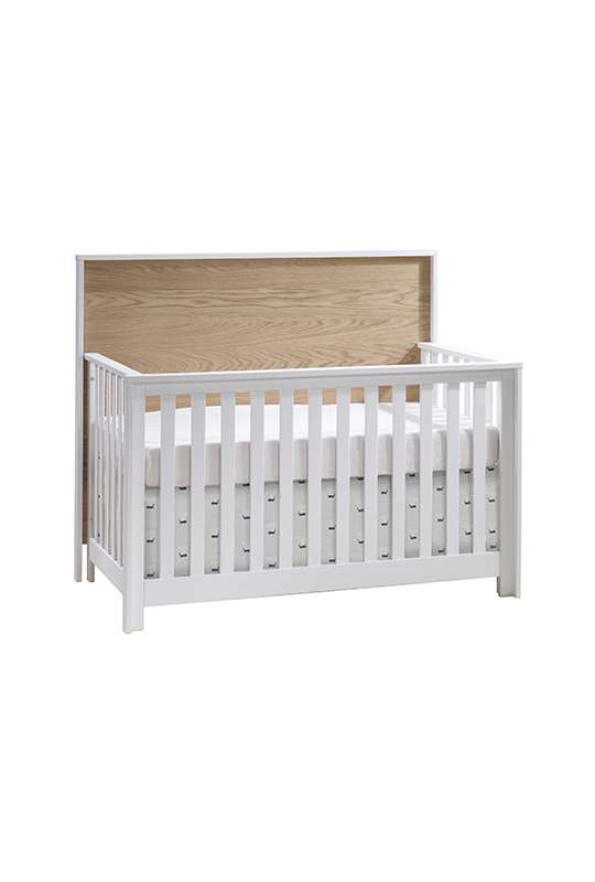Vibe white crib with natural oak wood headboard