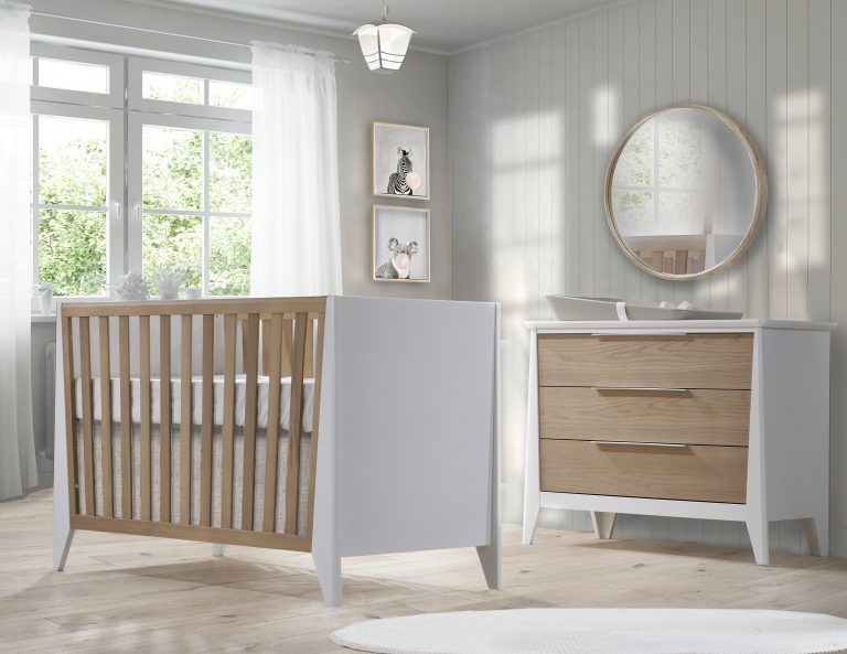 Beige nursery with white and natural oak wood crib and 3 drawer dresser