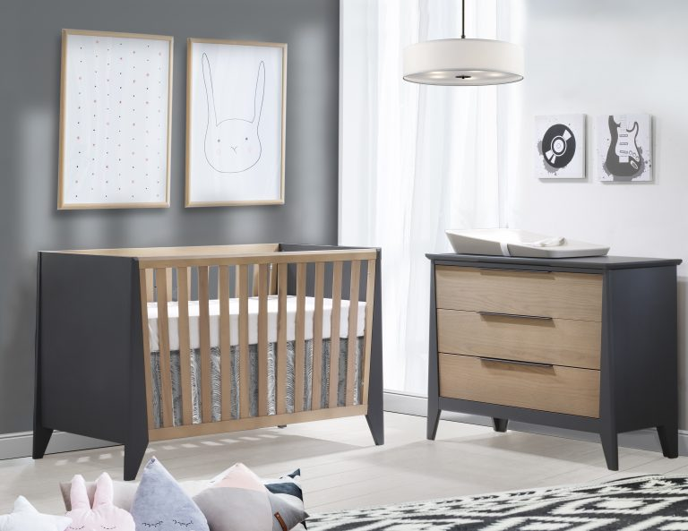 grey and white nursery with graphite and natural oak wood crib and 3 drawer dresser
