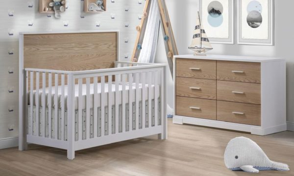 Light white nursery with cloud wallpaper and vibe collection furniture - Convertible Crib and 6 drawer double dresser in white and natural oak wood panels