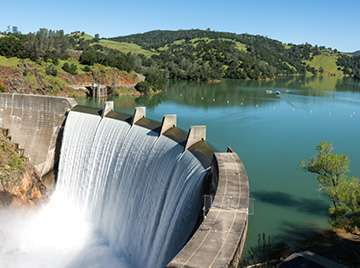 water dam with forest in the backgrounds