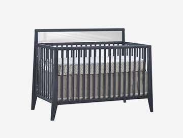 dark grey flexx crib with white headboard