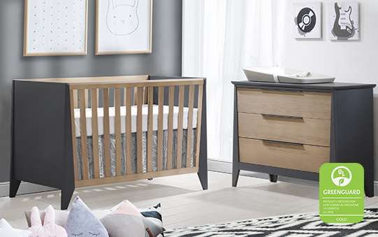Dark charcoal and natural wood crib and dresser